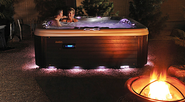 Couple enjoying their hot tub at night